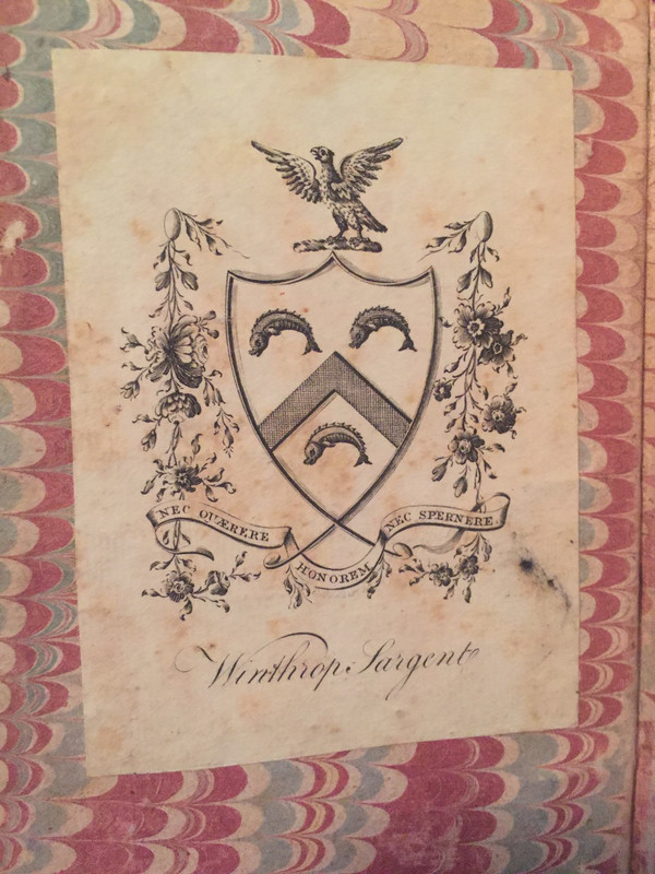 Close-up of book plate and Sargent family crest.