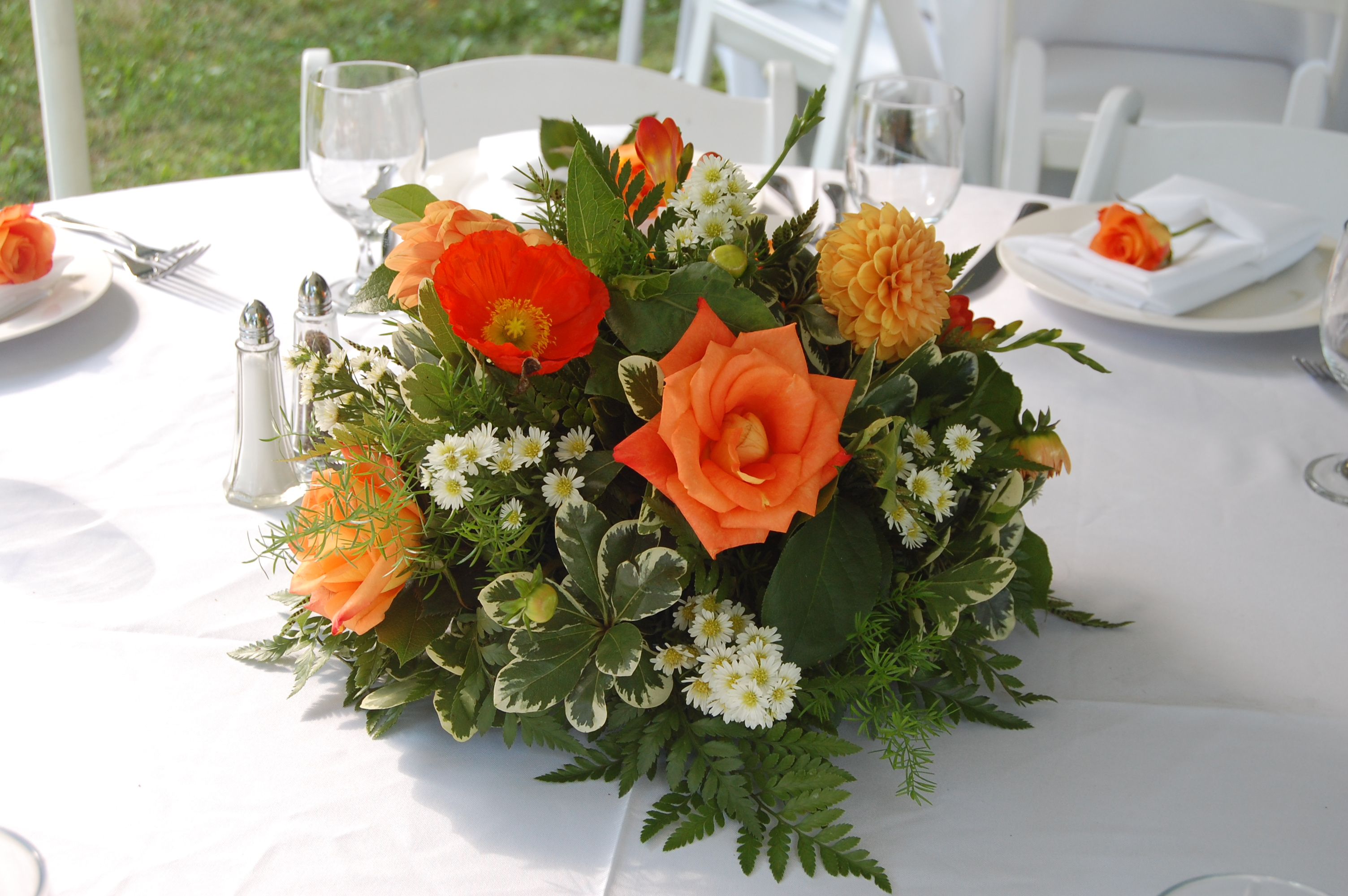Centerpiece of roses, dahlias, greens