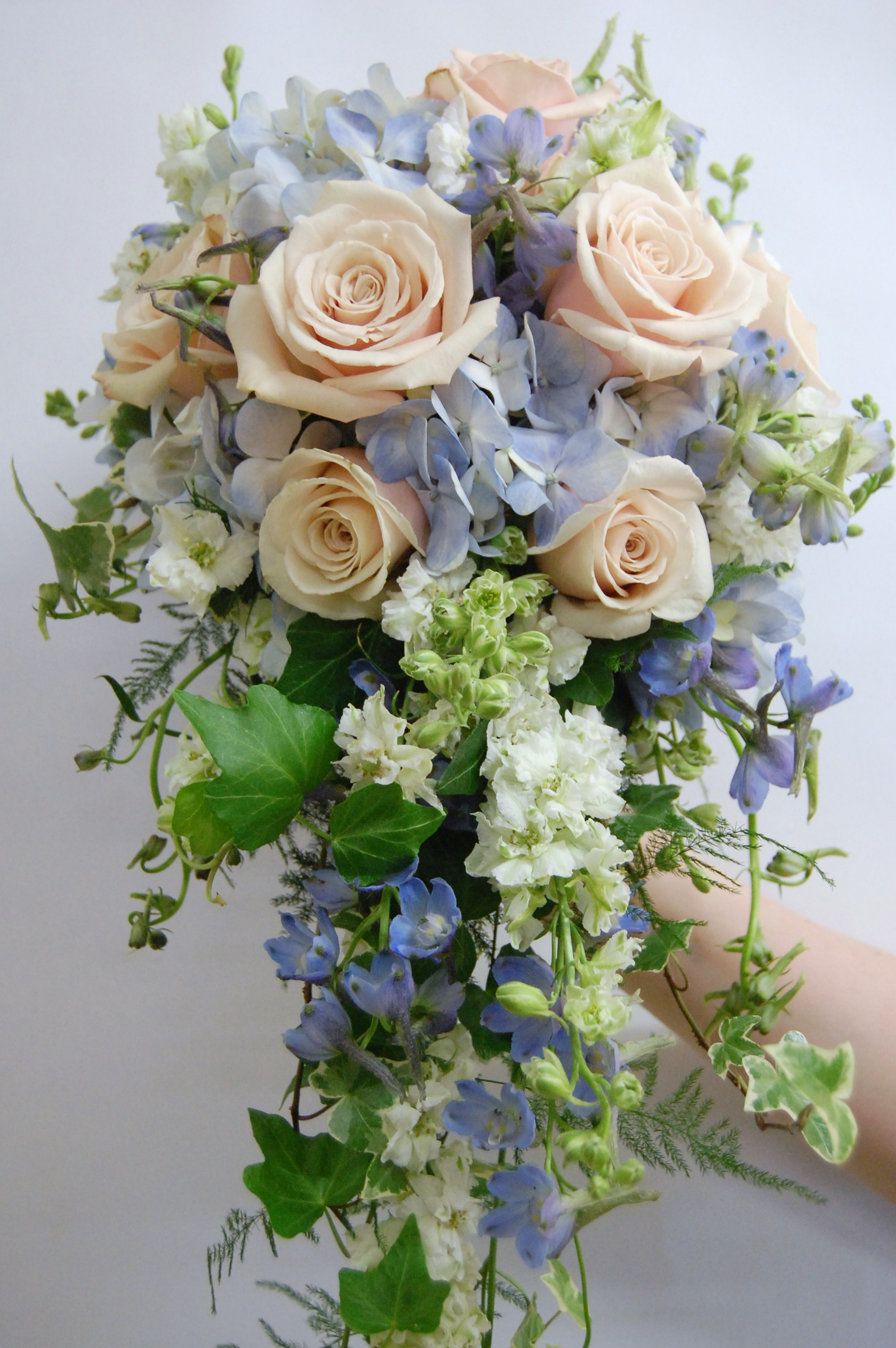 Cascade style- Sahara roses, blue hydrangea, delphinium and white larkspur