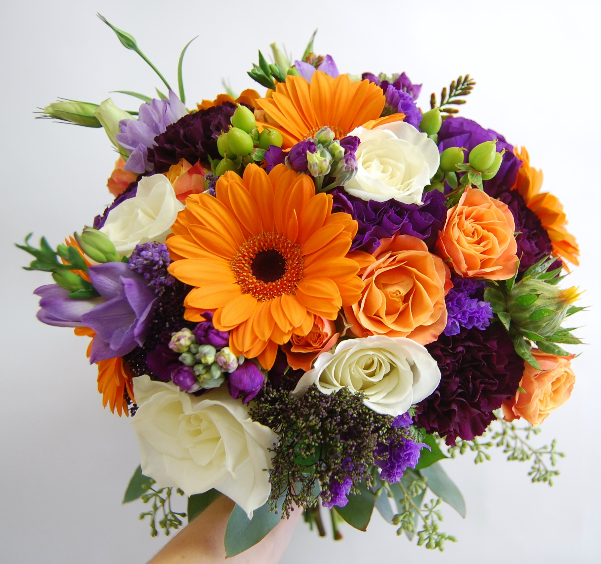 Orange gerberas white and orange roses, freesia carnations