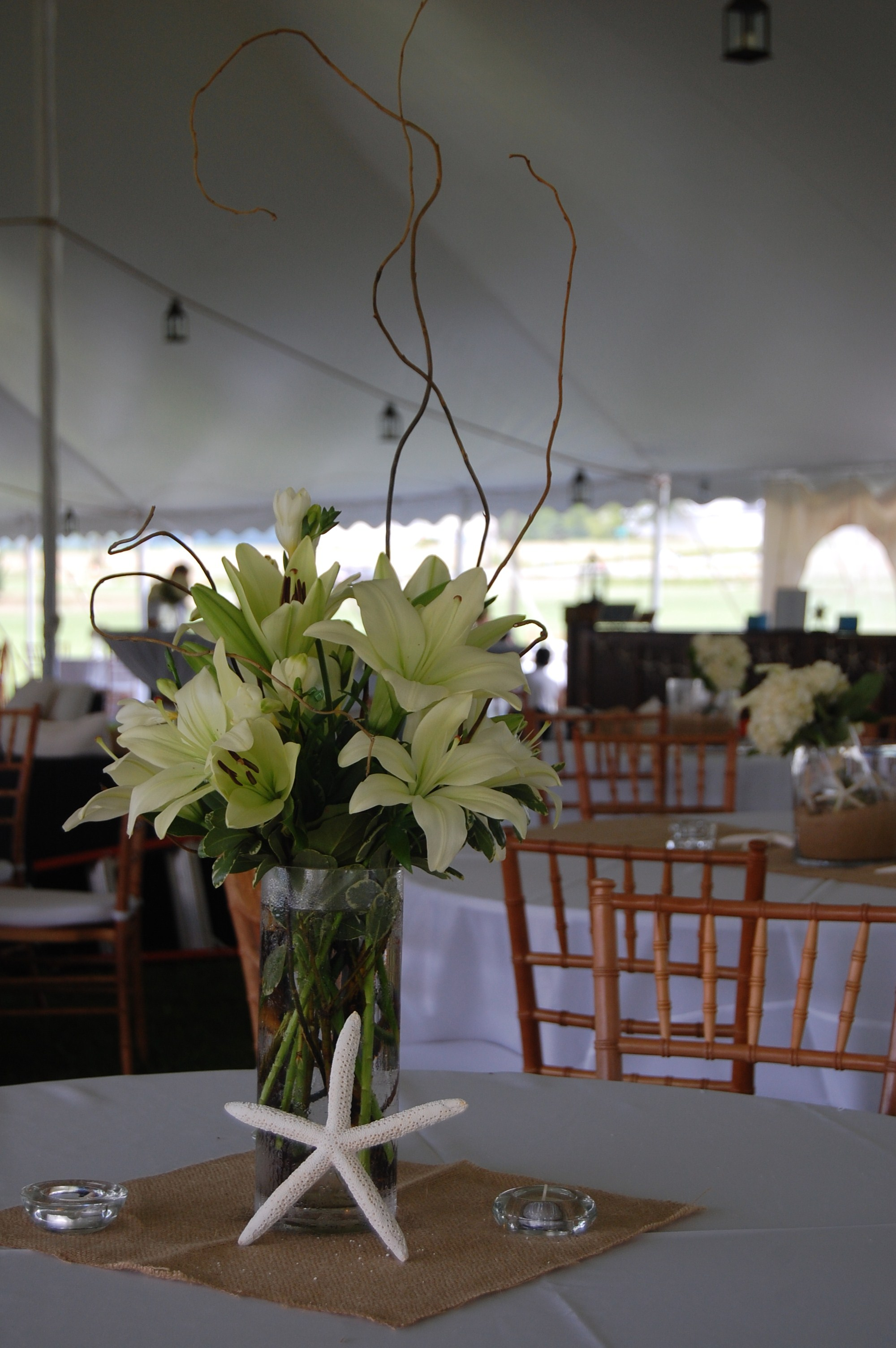 centerpiece with lilies and curly willow