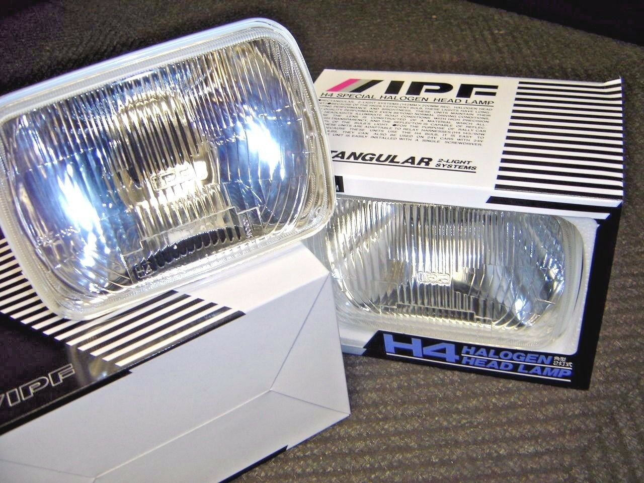 YOU ARE BIDDING ON A BRAND NEW PAIR OF IPF H4 CONVERSION HEADLIGHTS.    THESE ARE THE GLASS HOUSINGS THAT YOU WOULD NEED  IN ORDER TO RUN H4 HEAD LIGHT BULBS.    THESE ARE NEW.  THESE COME WITH OUT BULBS BUT YOU CAN FIND H4 BULBS ALMOST ANYWHERE.     THIS WILL FIT YOUR AE86 FROM 84-87   YOUR MR2 FROM 85-93 SW20 AND AW11   AS WELL AS CELICA SUPRA FROM 82-92 RA64 RA65 MA60 MA70  PICK UP TRUCKS      THESE ARE FOR OFF ROAD USE ONLY