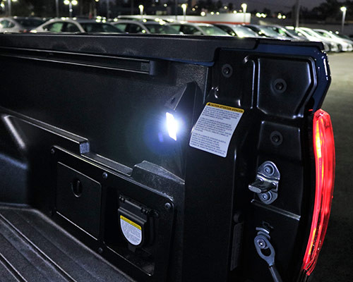Two separate light assemblies—on the inside bed walls and near the rear of the cargo area—provide excellent light distribution while loading and unloading. 2018 Tacoma Bed LED Lighting Kit (PT948-35160)
