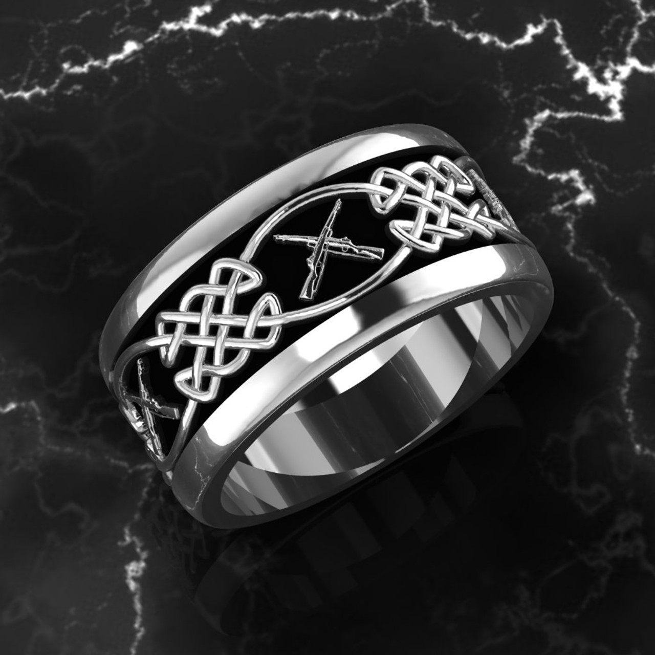 "Celtic Weave with Crossed Rifles  This band is comfort fit and 11 mm wide. Black background.   ""Made by Marines for Marines"" Available in Sterling Silver, 10k, 14k and 18k White or Yellow gold.   100% Satisfaction Guaranteed"