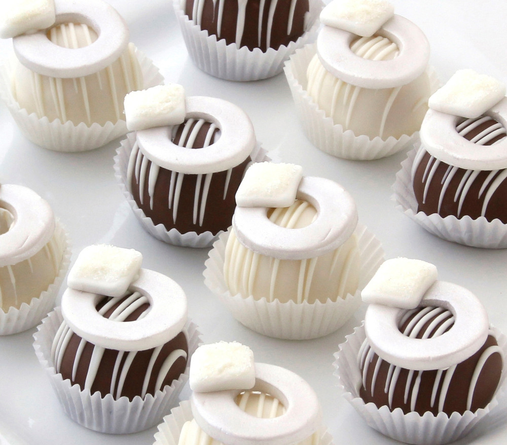 Say congrats with some delicious engagement ring cake balls.