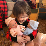 She loves her twin baby dolls