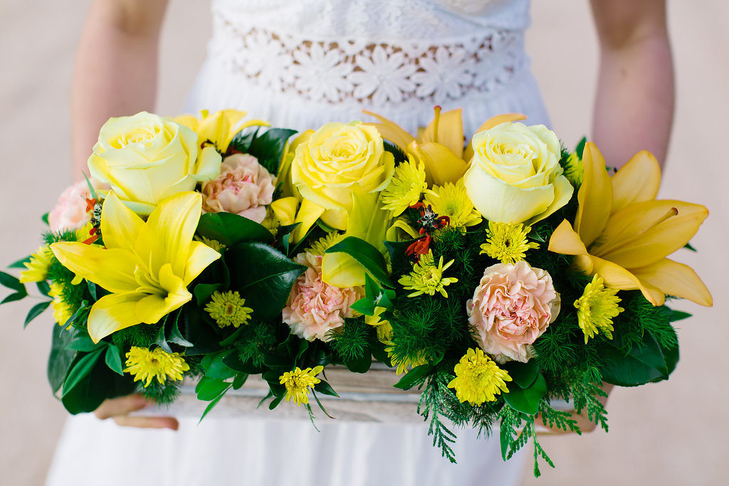 A SEASONAL COMBINATION OF CARNATIONS, ROSES, ASIATIC LILIES AND CHRYSANTHEMUMS.