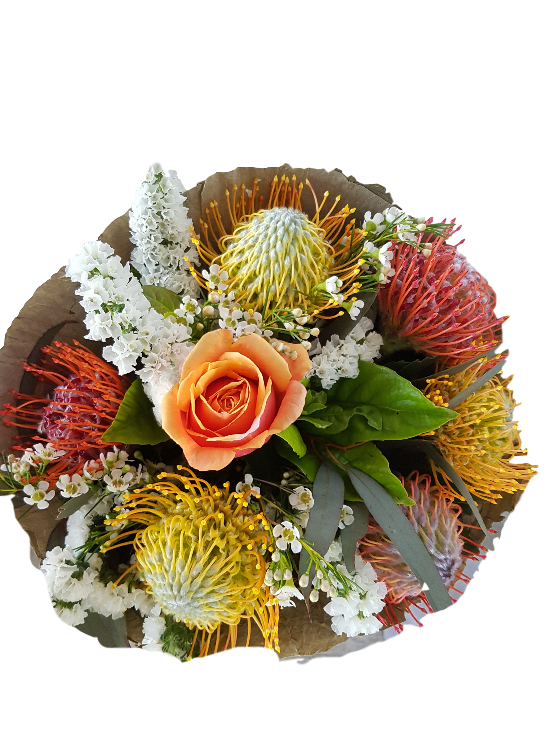 A SEASONAL MIX OF LONGER LASTING NATIVE FLOWER, STATICE, PINCUSHIONS, WAX AND A SINGLE ROSE.  NATIVE FLOWERS MAY CHANGE DUE TO AVAILABILITY .  FLOWERS WRAPPED IN A LOTUS LEAF.