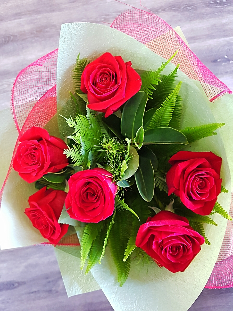 BOUQUET OF SIX RED ROSES AND COMPLEMENTING GREENERY
