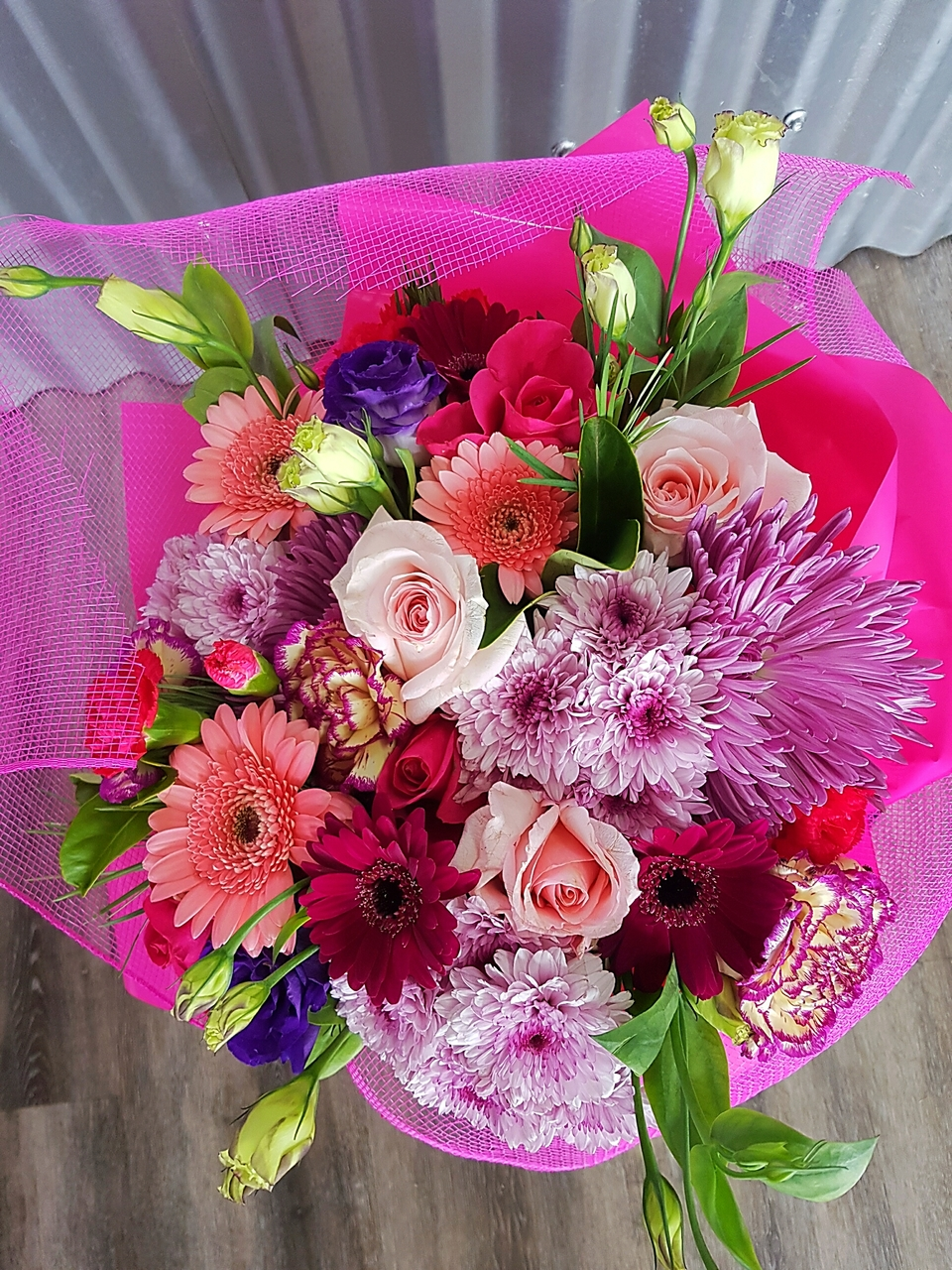 COLOURFUL MIX INCLUDING GERBERAS, CHRYSANTHEMUMS, DISBUDS, CARNATIONS, ROSES AND  SPRAY CARNATIONS.
