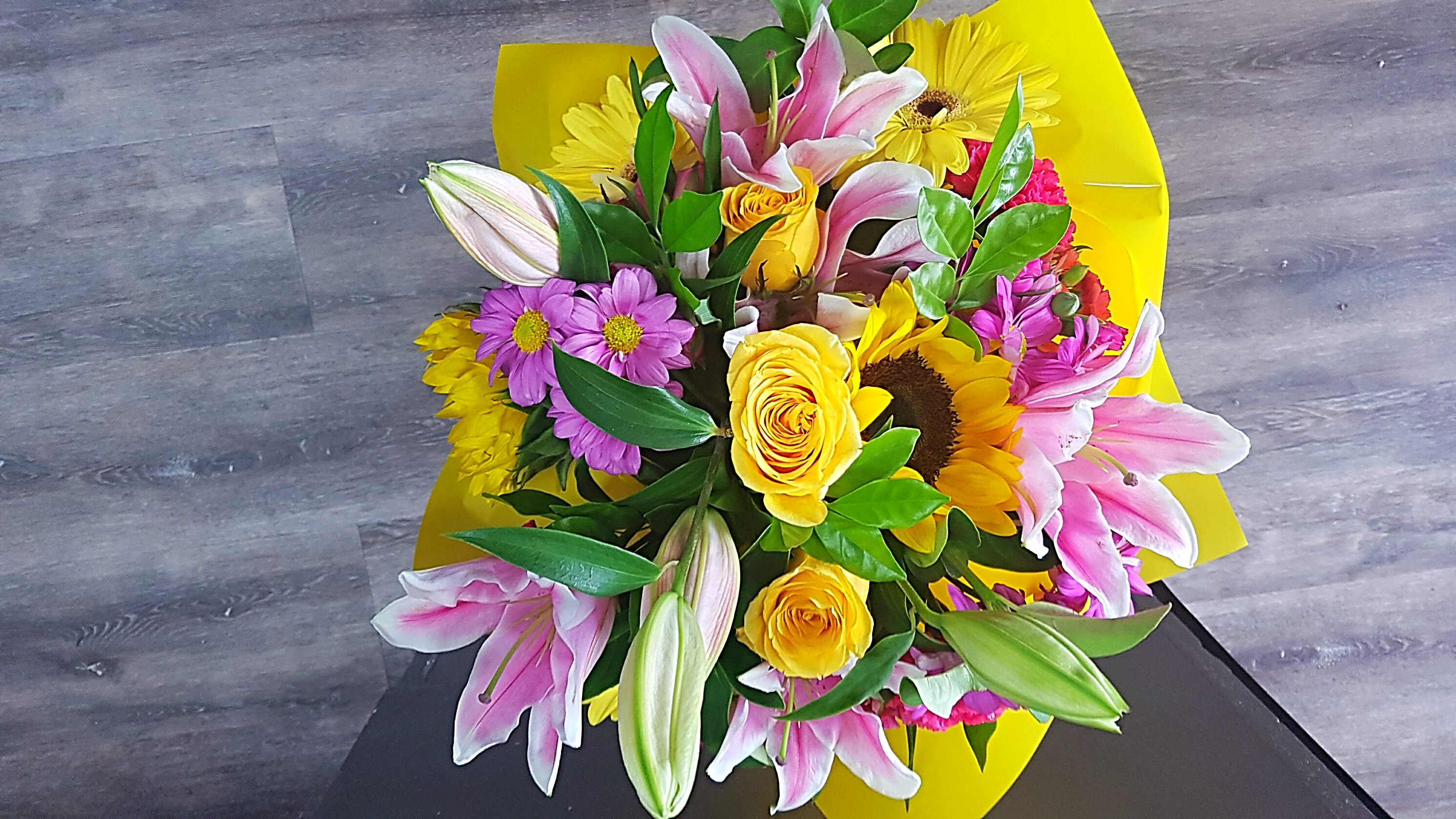 A BEAUTIFUL BOUQUET OF SCENT AND HAPPINESS. ORIENTAL LILIES FOR SCENT, SUNFLOWERS FOR JOY, CHRYSIES, AND CARNATIONS FOR LONGEVITY.