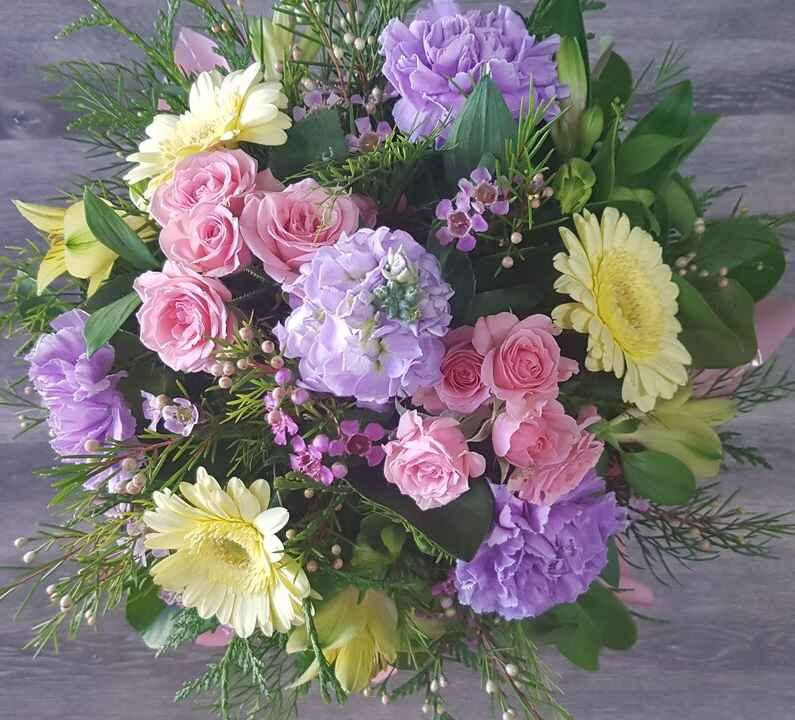 NICOLE, A BEAUTIFUL ARRANGEMENT OF BLOOMS IN PASTEL TONES IN A BOX