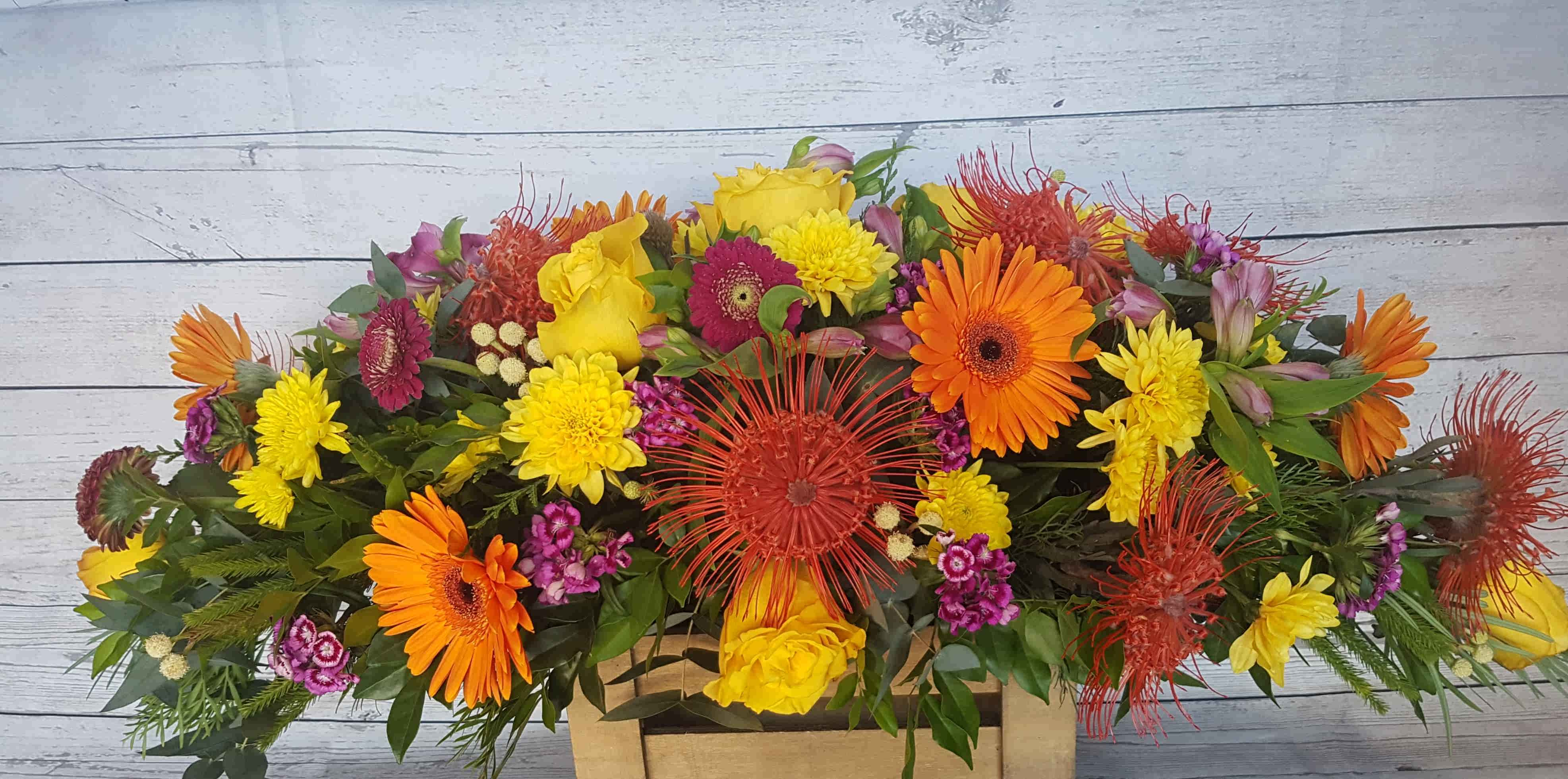 A SEASONAL MIX OF FLOWERS, WITH  A BRIGHT COLOUR PALETTE.