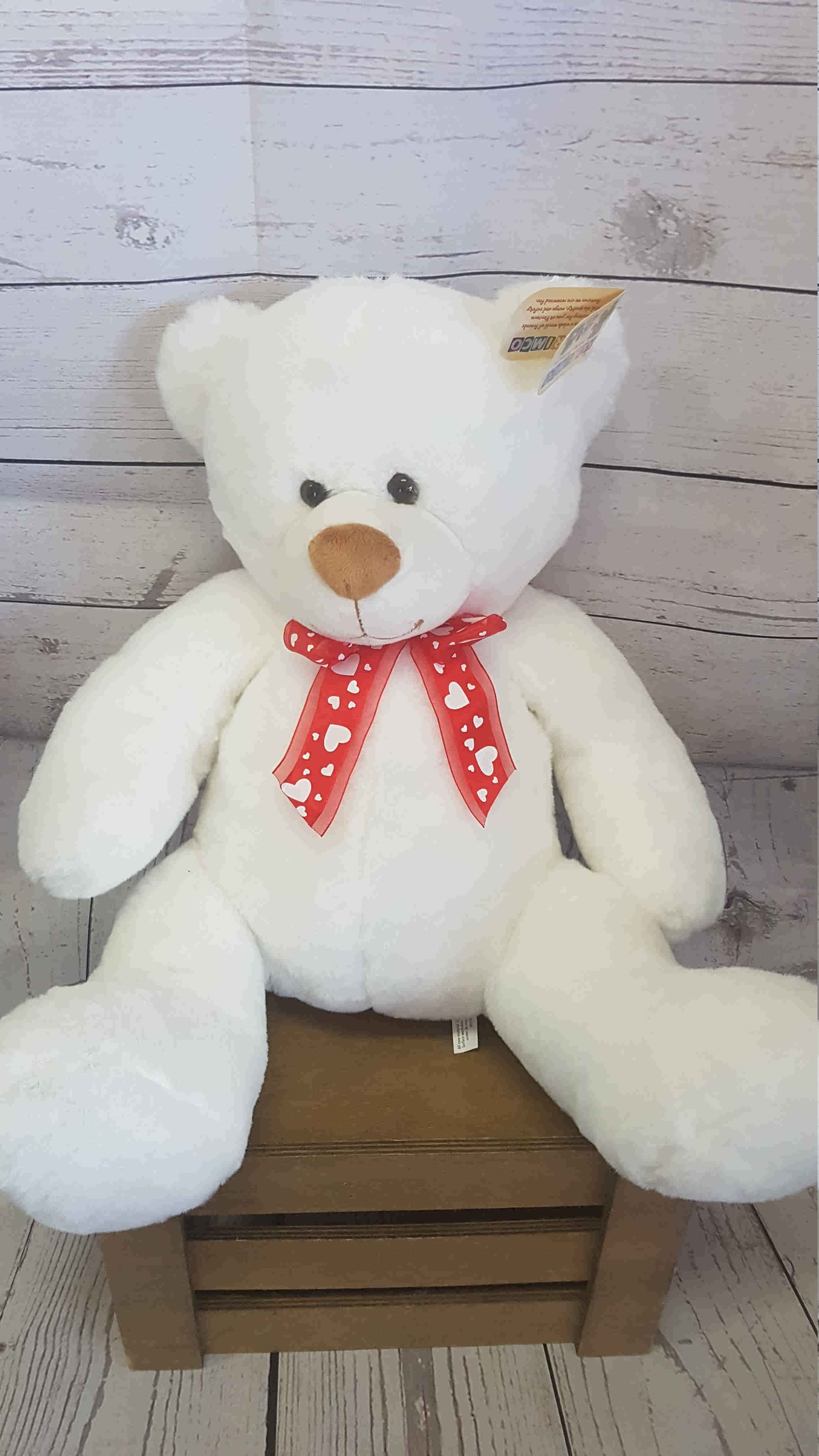 A stunning white teddy bear, to give comfort, when you are not there.