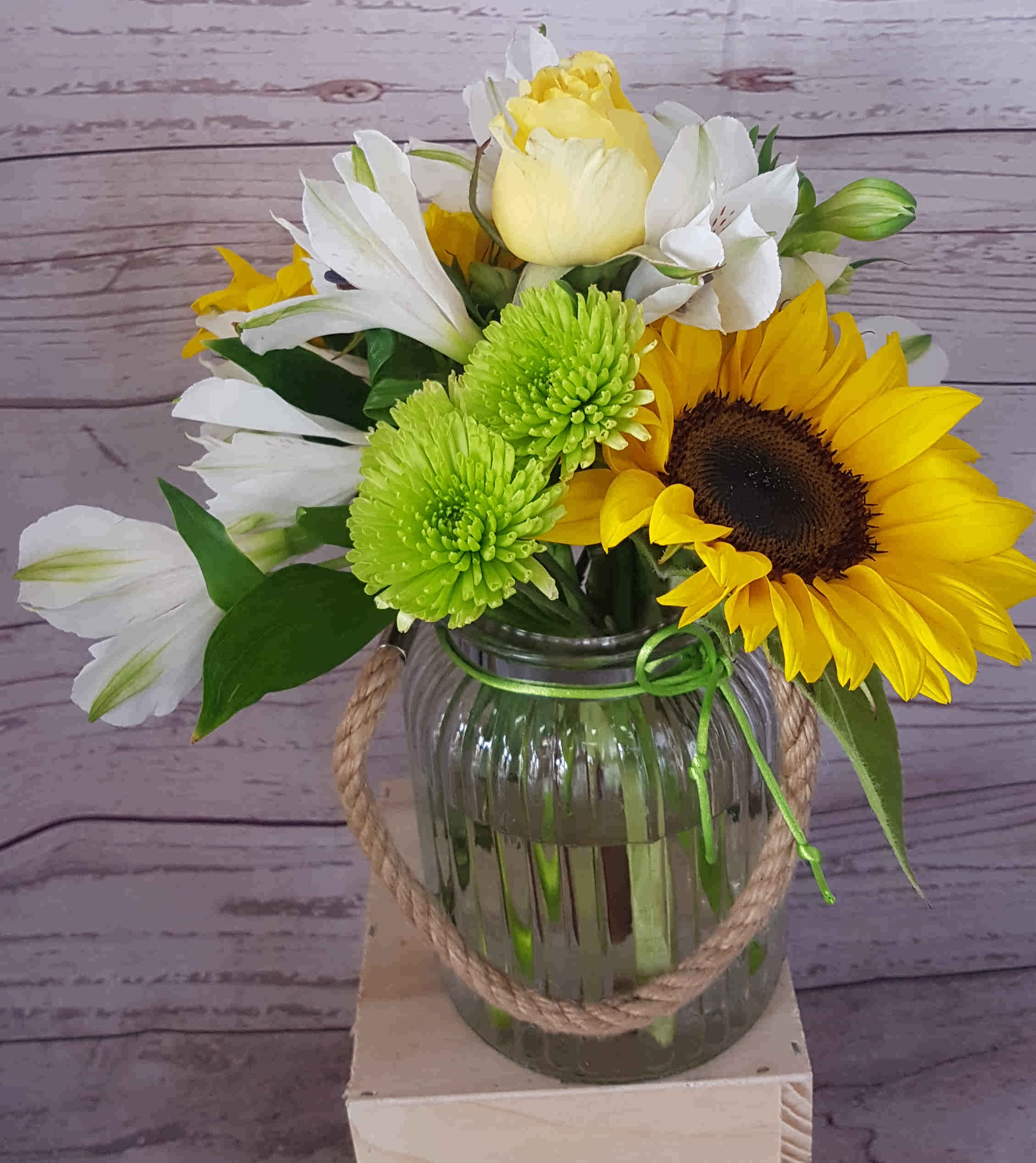 A sunny arrangement, that is sure to pop a smile on the recipient.  Vase included a perfect gift for hospitals, nursing homes and office.
