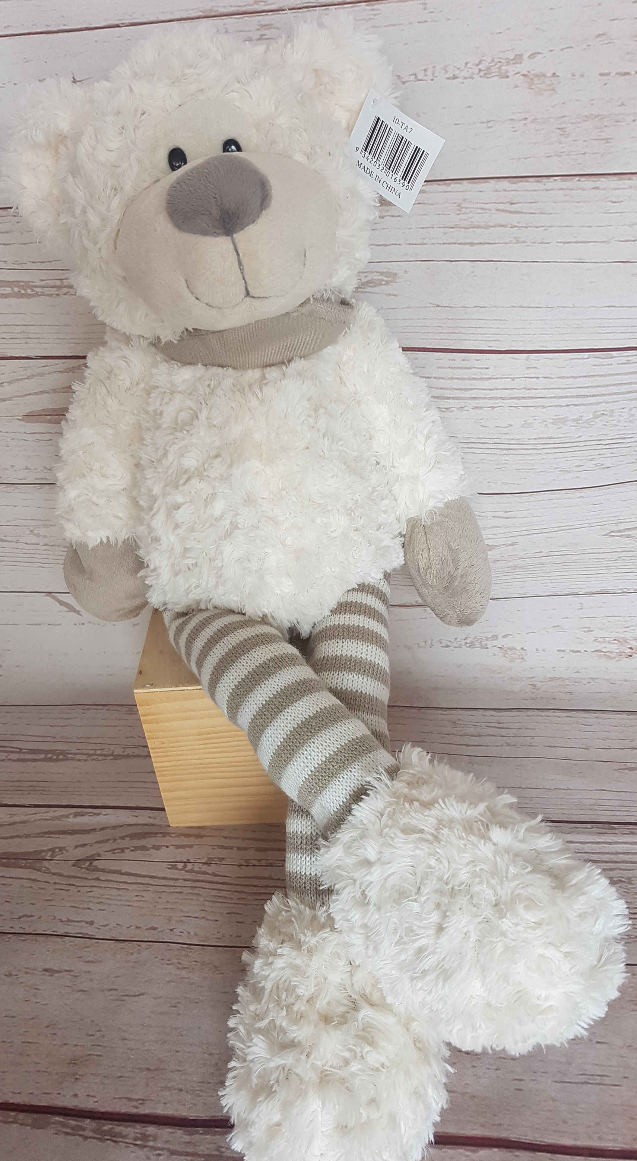 Cutie, a delightful, bear that is 60 cm in length, sure to become a treasured friend.