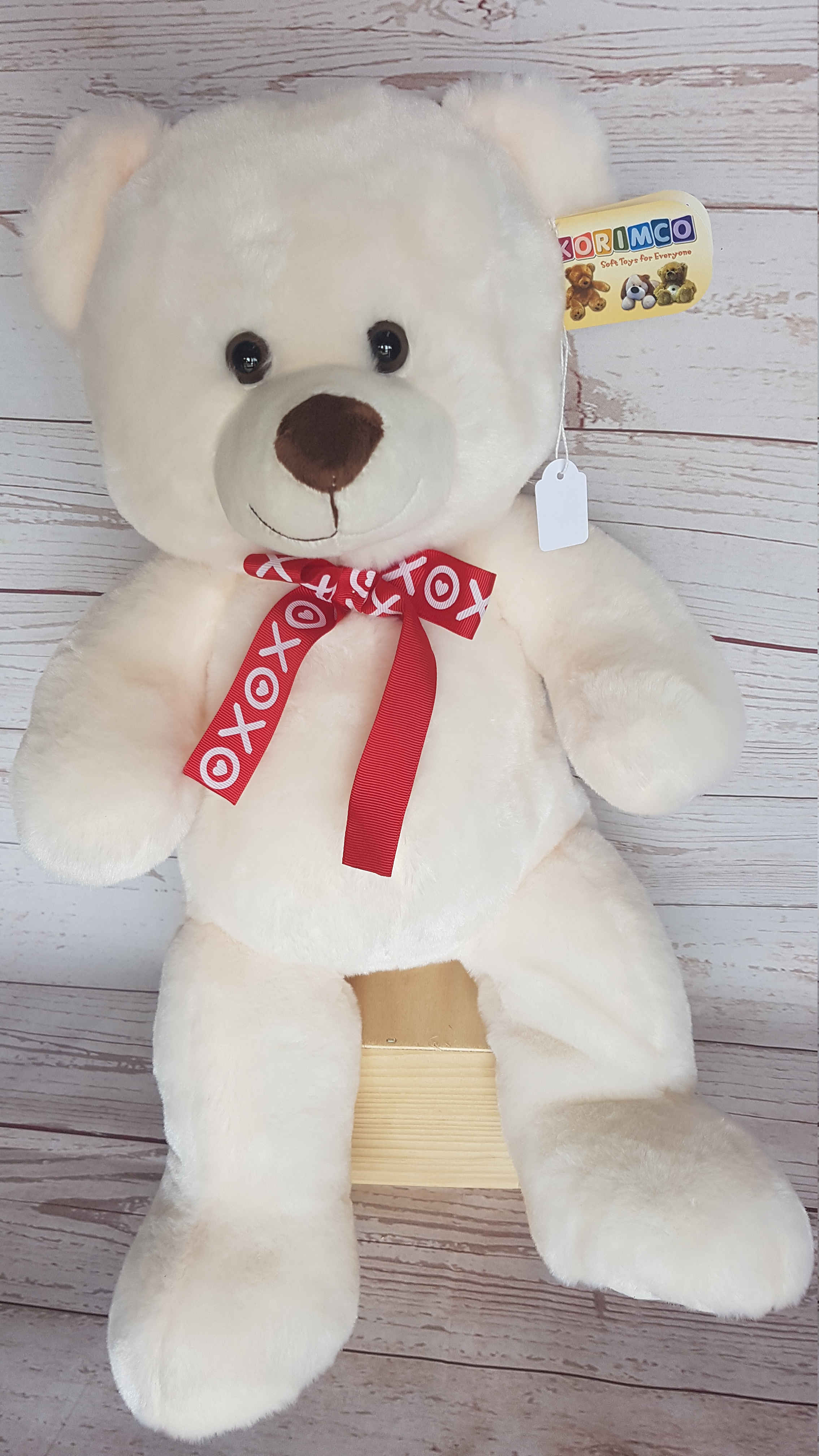 Kisses and cuddles, the cute, soft white bear who will be there to cuddle when you can't.