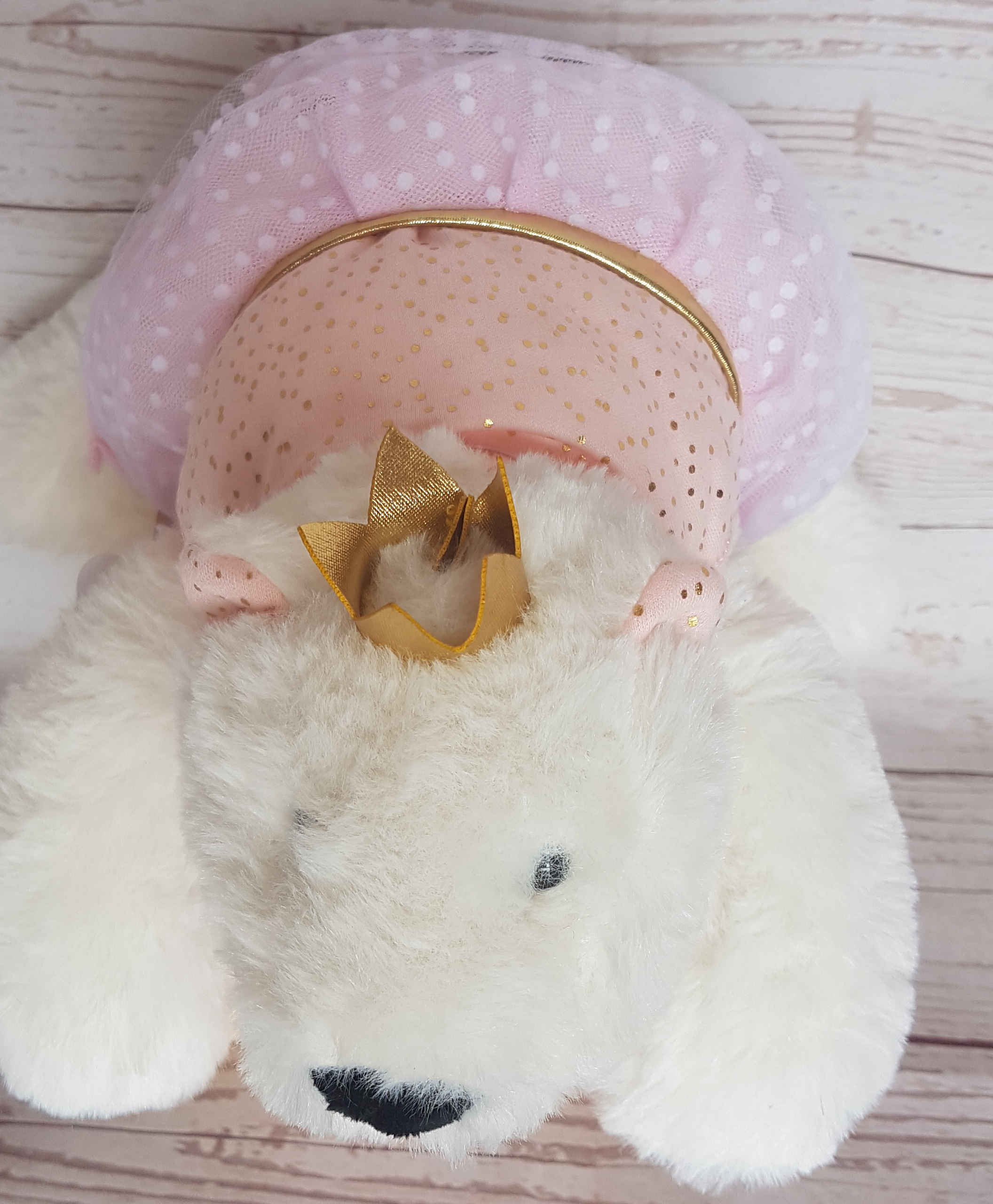 Confetti, would look beautiful on any little princess's bed.  This white polar bear, adorned with its crown, and tutu.