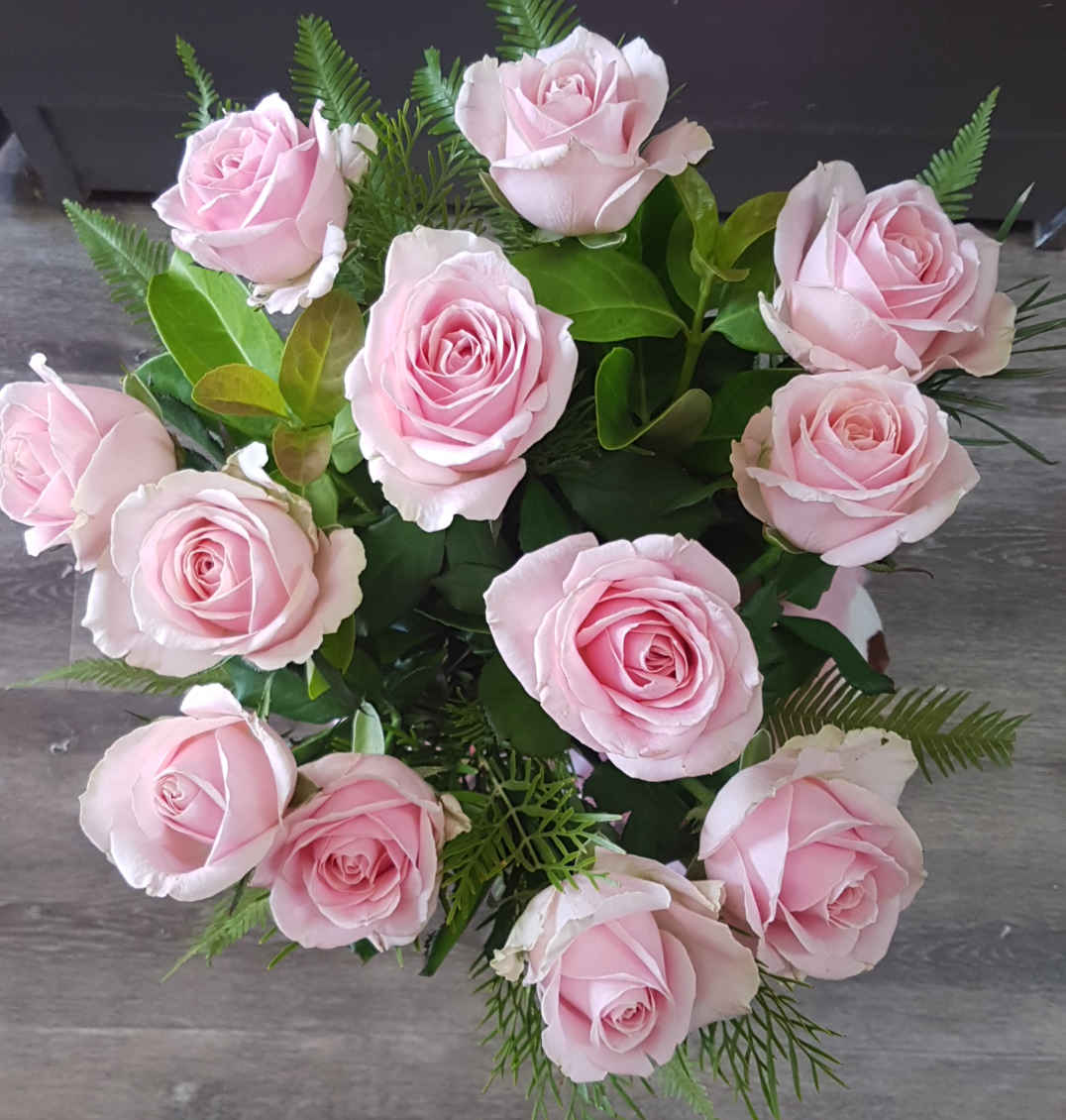 Choose rose colours  of pink, or yellow, purple, or white,  twelve in number with greenery