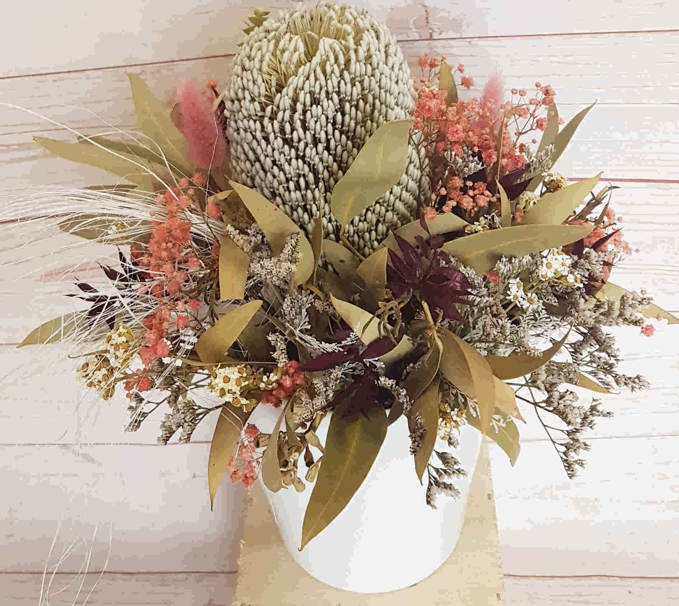 A beautiful bespoke dried and preserved arrangement that would adorn any table or desk.  No water necessary.