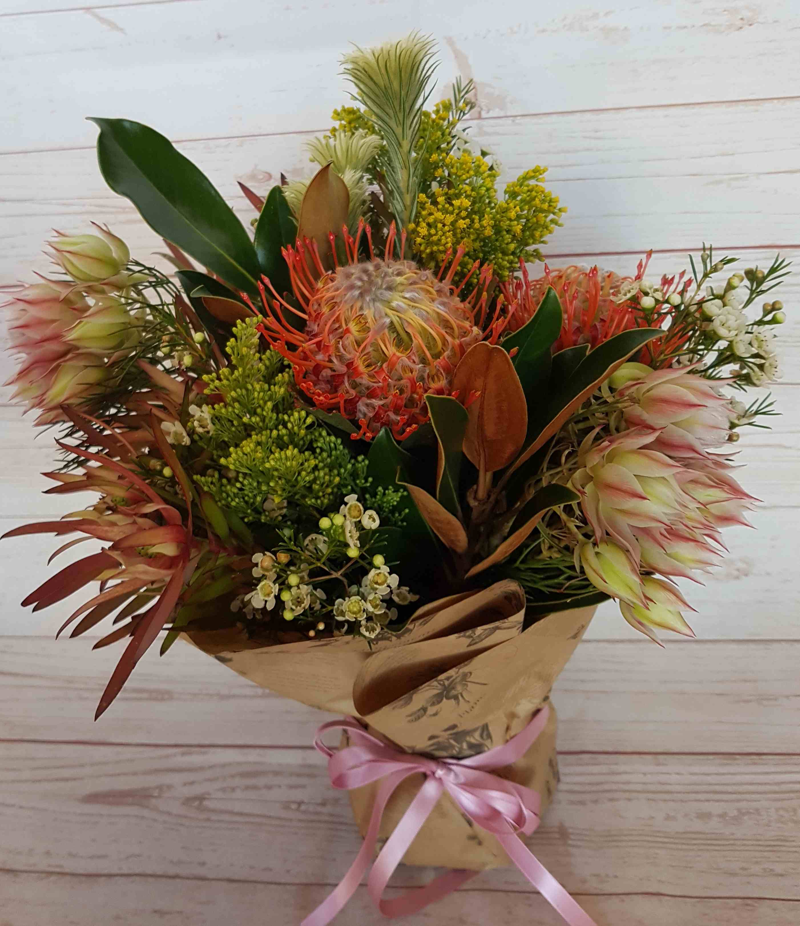 This native arrangement is suitable for a nursing home or hospital where space is limited.  The blooms are in water so less care is required by nursing staff, the natives are longer lasting, but give a beautiful focal point for someone convalescing.