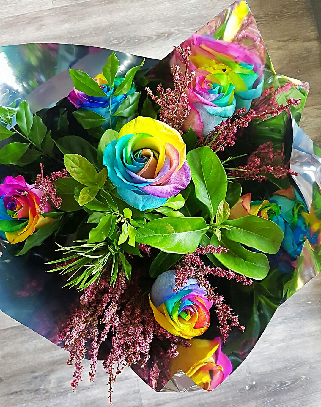 For a limited time enjoy the amazing colours of the rainbow roses. Six beautiful rainbow roses gift wrapped with greenery, will surely be a talking point with the recipient.