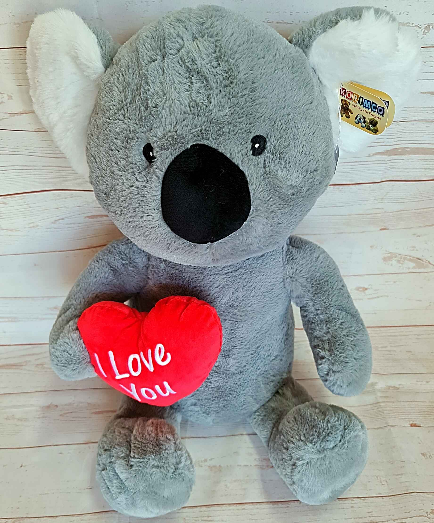 The very unique Snuggles the Koala, sits approximately 40cm in height, and is very cuddly.   With the message of love, Snuggles, is sure to melt hearts.