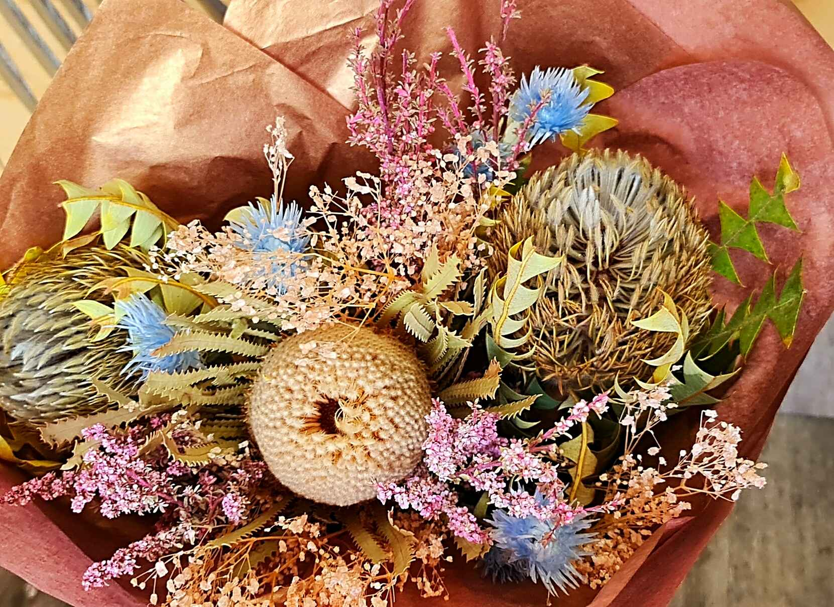 A beautiful, soft preserved and dried bouquet, in colour hues of neutral, pinks and baby blues.  No water required, for this beautiful bouquet.