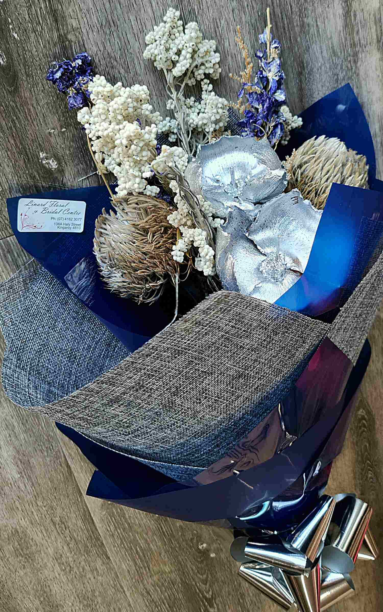 Azure is a bold bouquet of dried and preserved blooms.  If the recipient is a lover of blue, this bouquet will be enjoyed over and over.