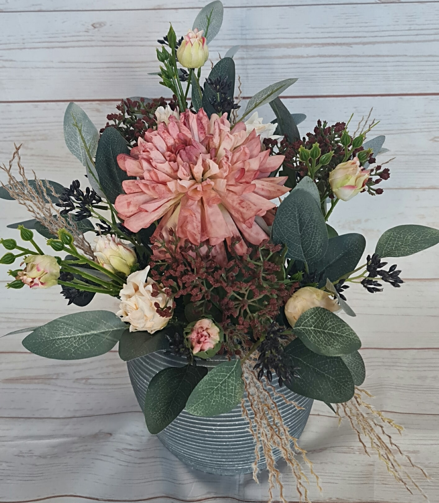 August is a whimsical artificial arrangement, in subtle tones, to suit an office space, hospital, nursing home.