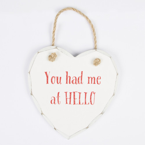 Our most popular plaques now come in special Valentines designs. The fun You Had Me At Hello plaque comes in an elegant ivory white distressed colour and hangs from a rustic coloured twisted rope. A lovely shabby chic decoration to use around the home and the perfect love statement. •Dimension - 14 x 13 x 1 cm •Material - MDF •Colour - Red, White/Cream