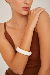 Oroton Lille Small Round Bangle in Pure White and Brass Based Metal With Precious Metal Plating/Resin for female