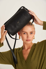 Oroton Brodie Soft Drum Bag in Black and Smooth Leather for female
