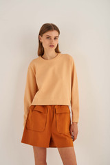 Oroton Relaxed Crew Knit in Pale Mango and 83% Viscose 17% Polyester for female