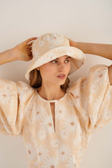 Oroton Cole Daisy Bucket Hat in Pale Mango and 100% Linen for female