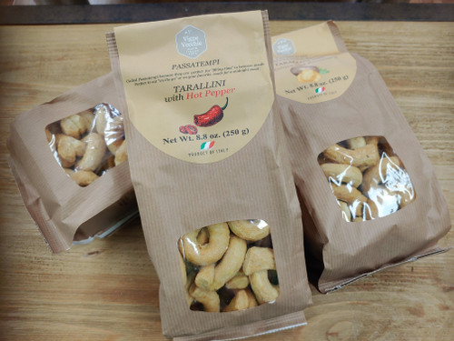 "Taralli ""Love Knot"" crackers with Chili pepper.  Like a cracker, bread stick, pretzel all rolled into one but better. A soft, no yeast dough made with olive oil and white wine. Boiled then baked.  These crackers are spicy, great as an appetizer, snack with wine or mixed drinks."