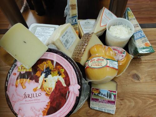 Wine Cheese from Umbria, Pecorino with White Truffles, Piave, Ubriaco, Gorgonzola, Pecorino Romano, Fontina, Manchego,  Aged Balsamic Cipollini, Parmesan Reggiano,  Smoked Mozzarella, Scamorza, Burrata w/Black Truffle, Goat Cheese Crumbles, Shredded Parmesan.