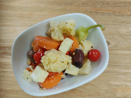 Antipasto Salad made with Giardiniera; sweet pepper drops, smoked provolone cheese, sun-dried tomatoes, Pinot Noir Balsamic, EVOO; and Top Secret. Great as a side dish, appetizer plate.  All of our marinated products are made with EVOO which congeals in the refrigerator.  For maximum flavor and color; please leave product set at room temperature for 20 minutes before serving.