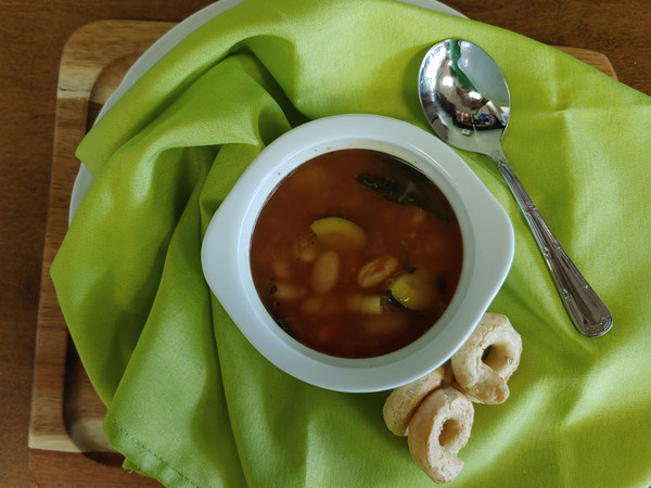 Fresh In-House Minestrone Soup; made with fresh zucchini, carrots, celery, spinach, garlic, basil, and onions. EVOO from Two Olive Trees, cannellini beans, whole peeled tomatoes, ditalini pasta all gently simmered in chicken broth.