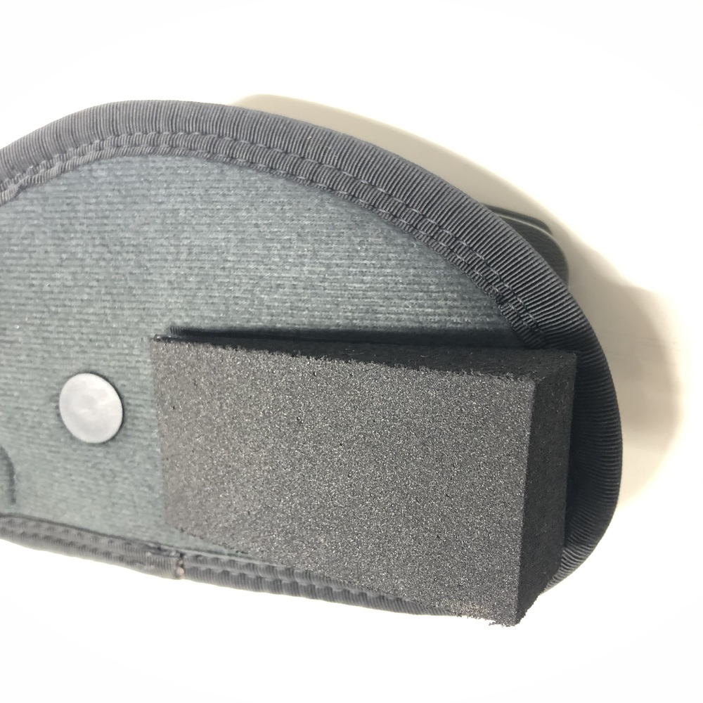 Close up neoprene foam wedge to reduce printing of the firearm