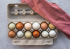 Product photo of open Local Hens® Jumbo Cell No Grade/No Size Printed Paper-Pulp Carton with UPC filled with multi-color eggs
