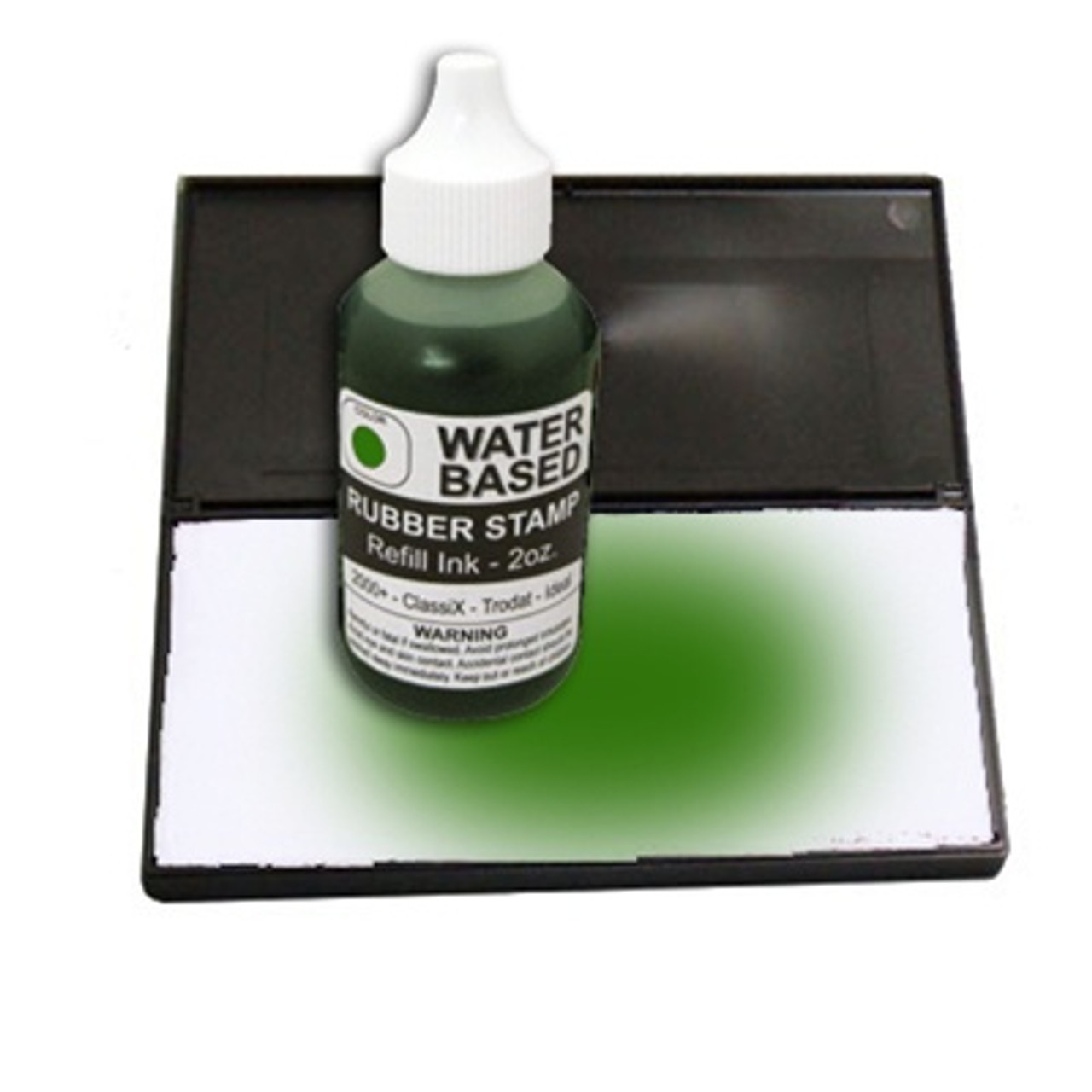 Dry stamp pad with green ink bottle