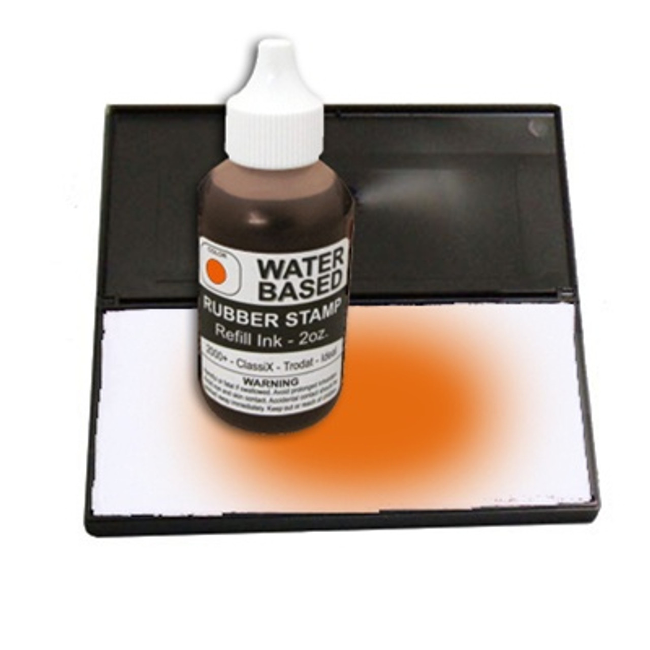 Dry stamp pad with orange ink bottle