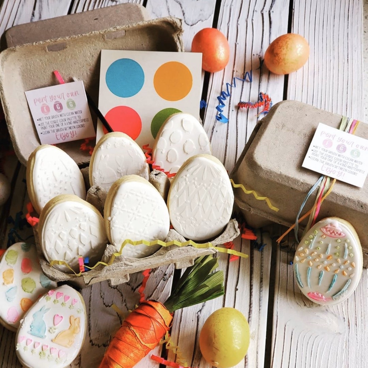Brown paper pulp carton filled with an easter egg cookie decorating craft.