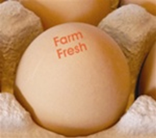 brown egg stamped with the phrase 'farm fresh'