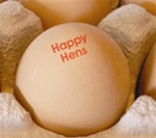 Brown eggs stamped with the phrase happy hens