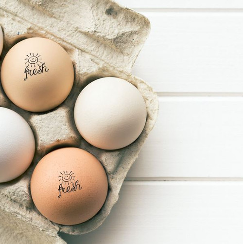 fresh egg with smiling sun egg stamp from the egg carton store