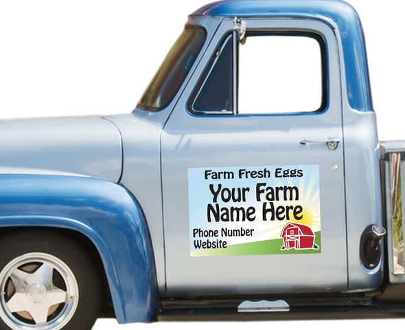 Magnetic Vehicle Sign: Sunrise Barn sign on a blue pickup truck