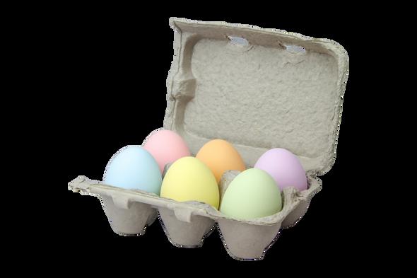 Six fake ceramic pastel multicolored nest eggs on a white background