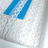 Narrow flat crochet lace in white on a 50 yard card.